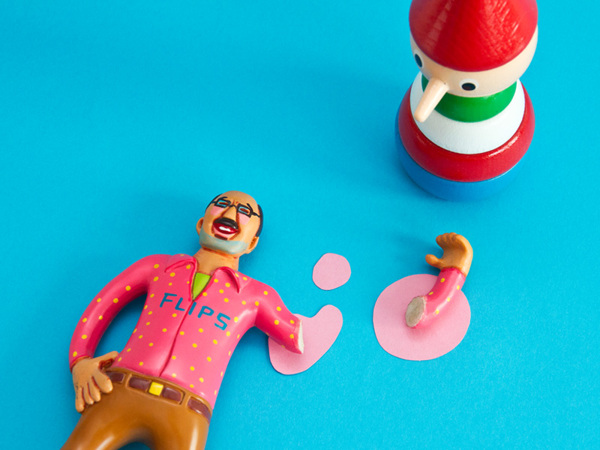 Toy man with arm cut off - Art Direction by Driv Loo