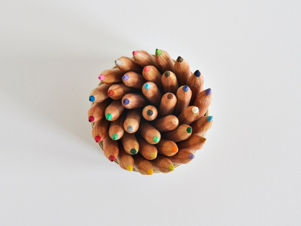 Colored pencils in a sprial - Art Direction by Driv Loo