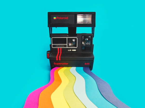 Polaroid camera with rainbow - Art Direction by Driv Loo