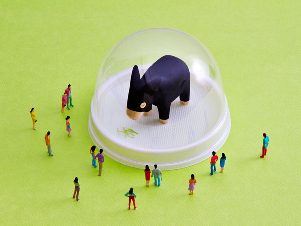 Toy animal surrounded by toy people- Art Direction by Driv Loo