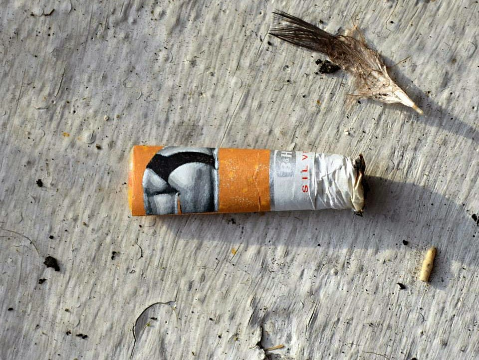 Woman's Rear End Stenciled on a Discarded Cigarette Butt - Artwork by Penny