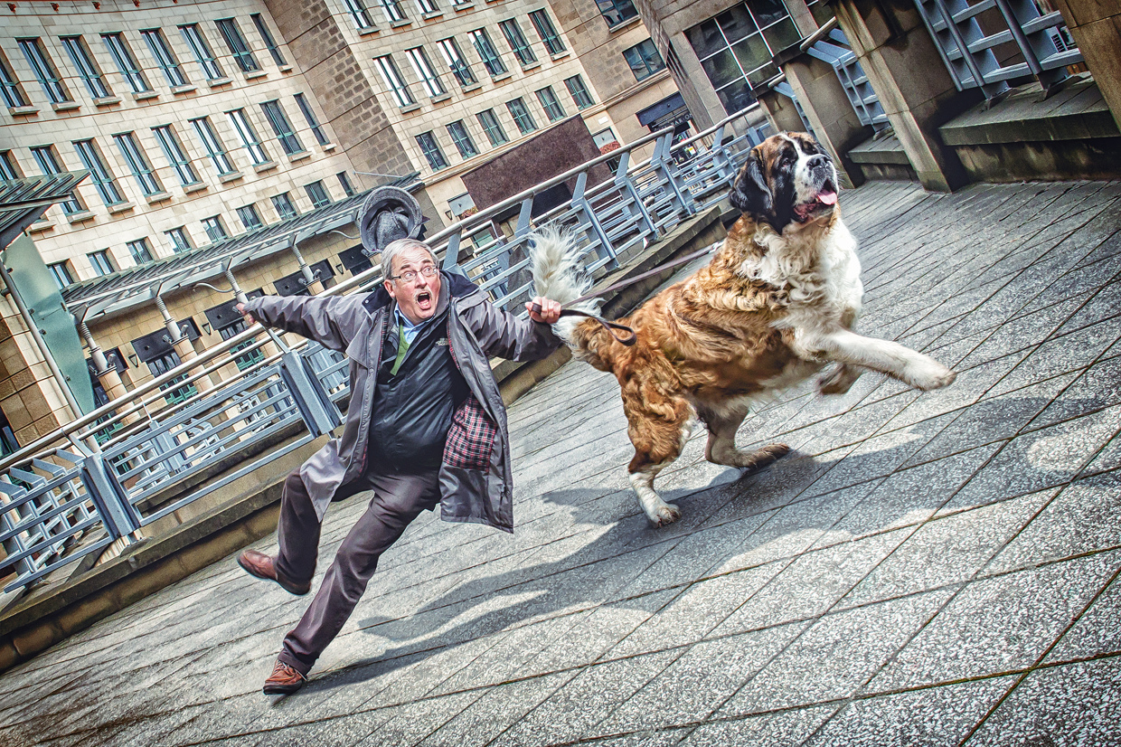 Man Being Pulled by a Dog - Photo by Lee Howell
