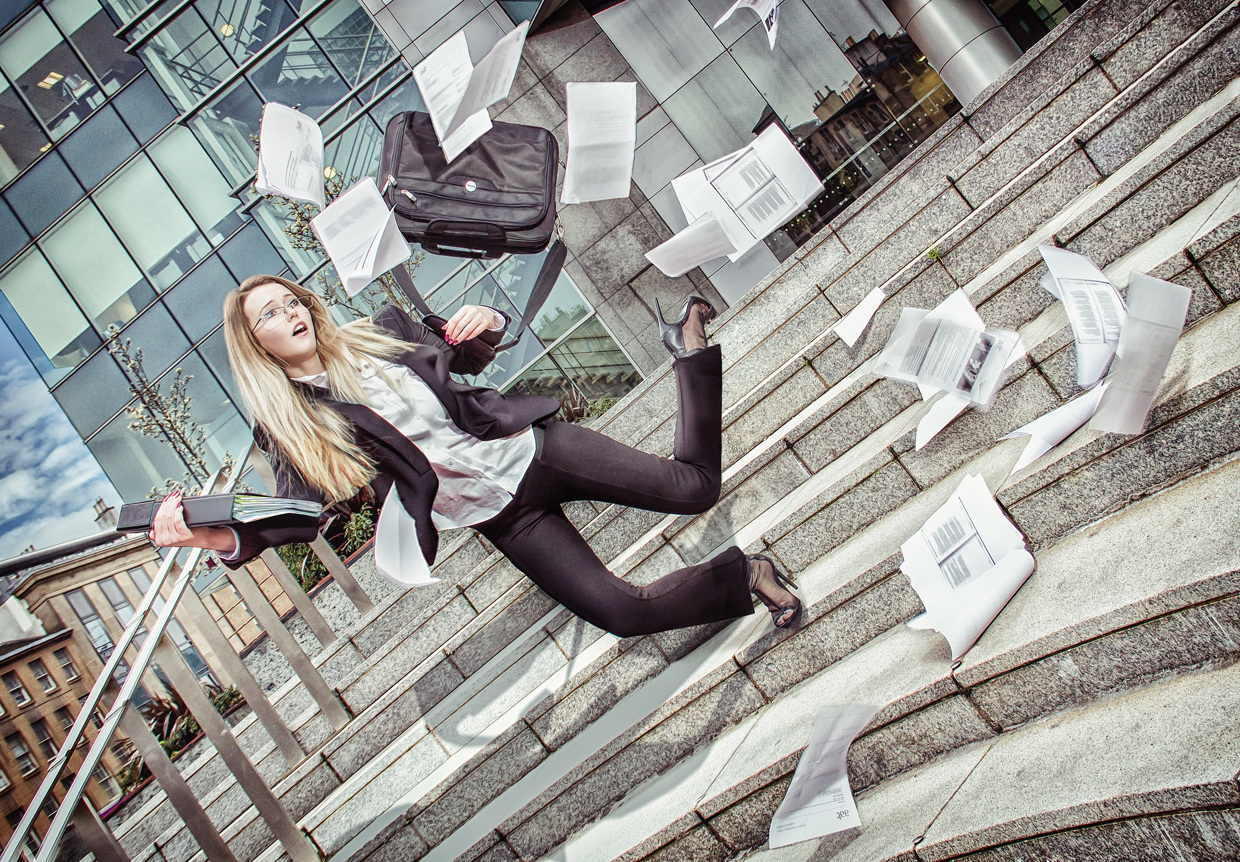 Business Woman with Scattered Papers - Photo by Lee Howell