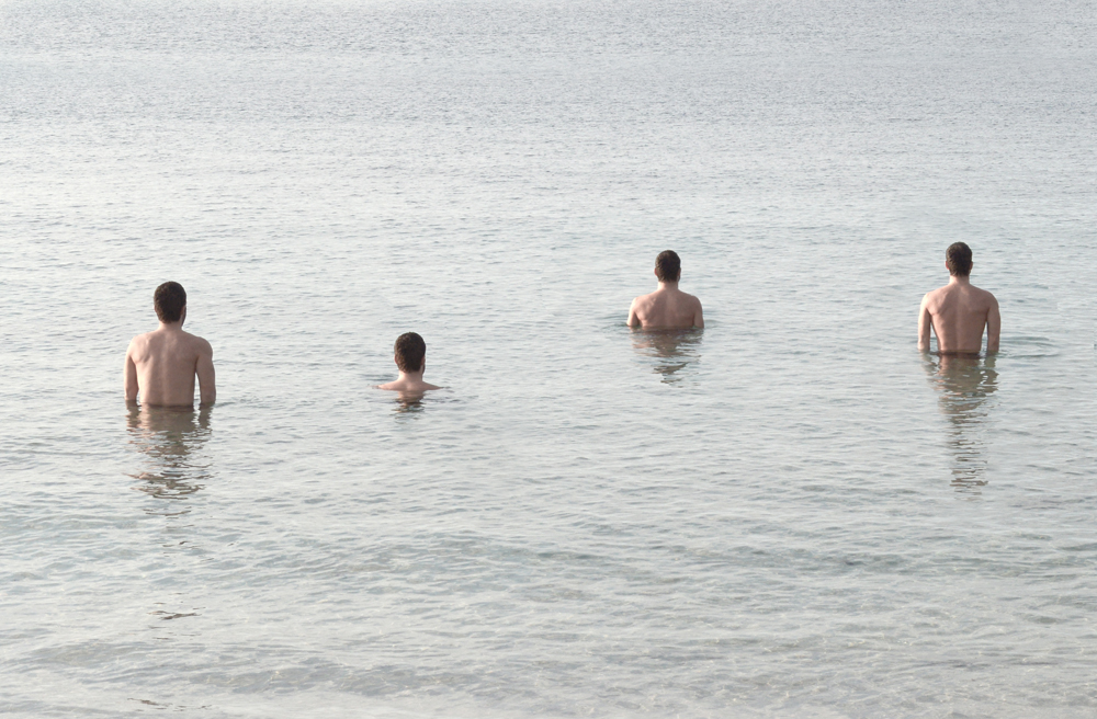 Men in water  - Photo by Kostis Fokas