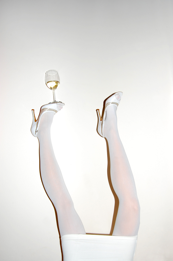 Legs in air with wine glass - Photo by Kostis Fokas