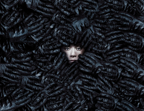 Face in a pile of gloves - Portrait by Flora Borsi