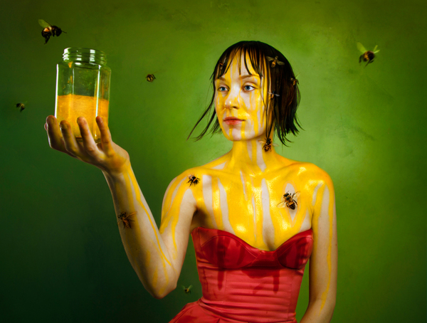 Woman with honey bees - Portrait by Flora Borsi