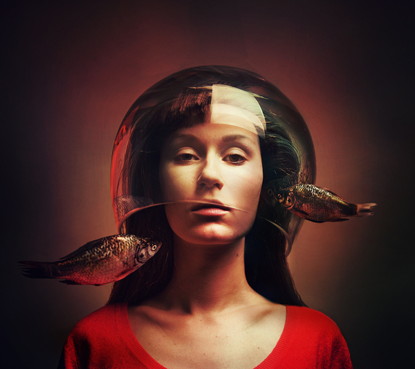 Woman with head in fishbowl - Portrait by Flora Borsi
