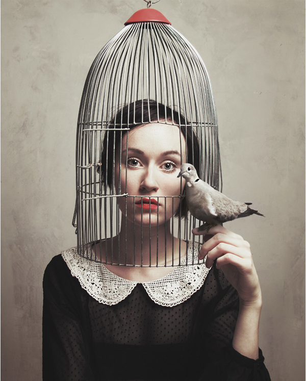 Woman with head in birdcage - Portrait by Flora Borsi