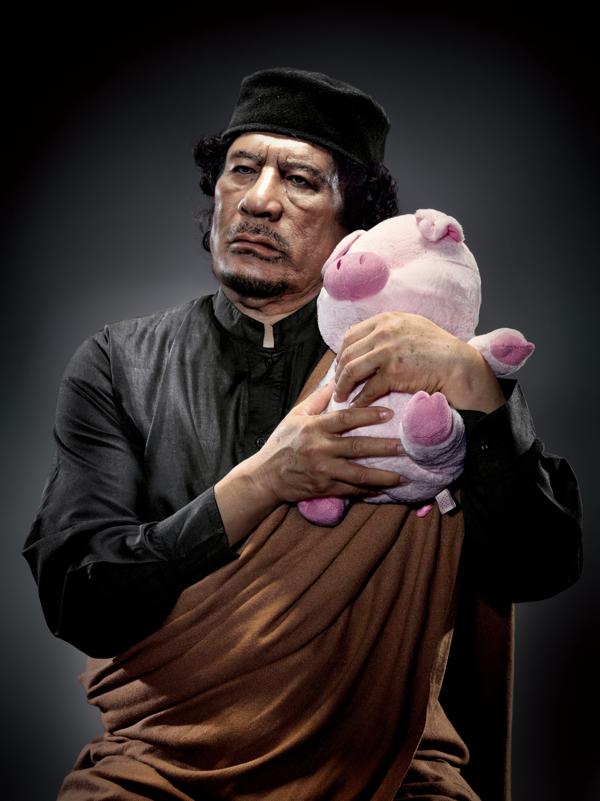 Muammar Gaddafi with Toy Pig – by Chunlong Sun