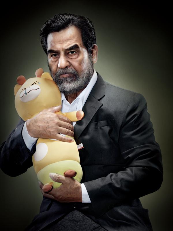 Saddam Hussein with Toy Animal – by Chunlong Sun
