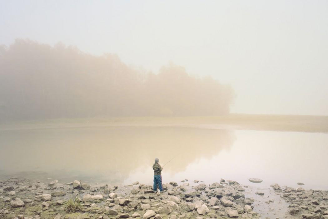 Boy fishing, Paks, Hungary - Photo by Ákos Major