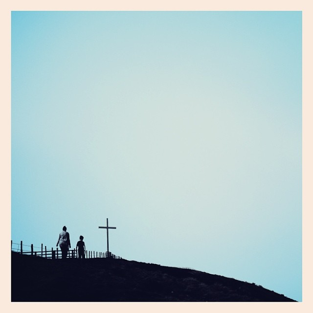 The Easter family walk, the cross on the hill and the powder blue sky. - iPhone photo by Tony Hammond