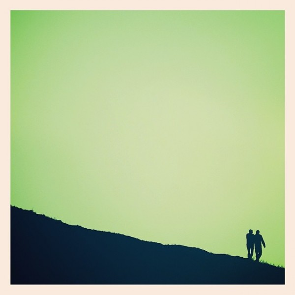 The two lovers, the sloping hillside and the greenumptious sky. - iPhone photo by Tony Hammond