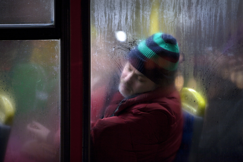 Winter London Bus Passengers - Through a Glass Darkly - Photo by Nick Turpin