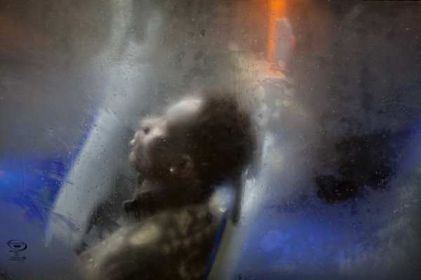 Winter London Bus Passengers - Through a Glass Darkly - Photo by Nick Turpin