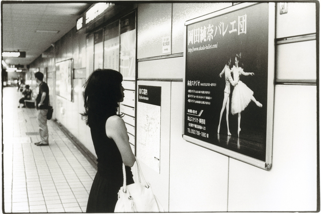 Untitled - Girl Looking at Ad - Photo by Junku Nishimura